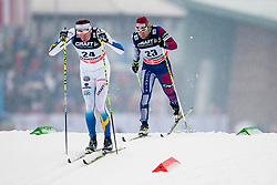 Daniel Richardsson of Sweden and Martin Bajcicak of Slovakia during mens 10km Classic individual start of the Tour de Ski 2014 of the FIS cross country World cup on January 4th, 2014 in Cross Country Centre Lago di Tesero, Val di Fiemme, Italy. (Photo by Urban Urbanc / Sportida)