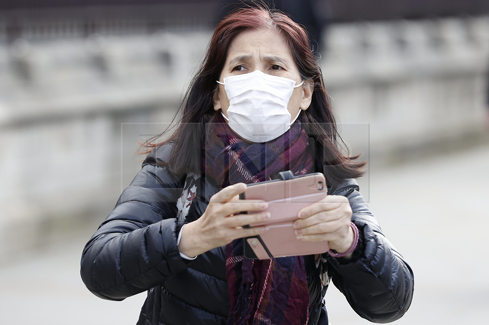 © Licensed to London News Pictures. 02/03/2020. London, UK. People outside Parliament wear face masks. This morning Prime Minister Boris Johnson held a COBRA meeting to discuss the UK response to the coronavirus. Photo credit: Peter Macdiarmid/LNP