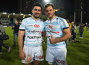 Racing 92 players Etienne Dussartre (L) and Luc Barba (R) stop on the pitch after the Natixis Cup rugby match between French team Racing 92 and New Zealand team Otago Highlanders at Sui San Wan Stadium in Hong Kong