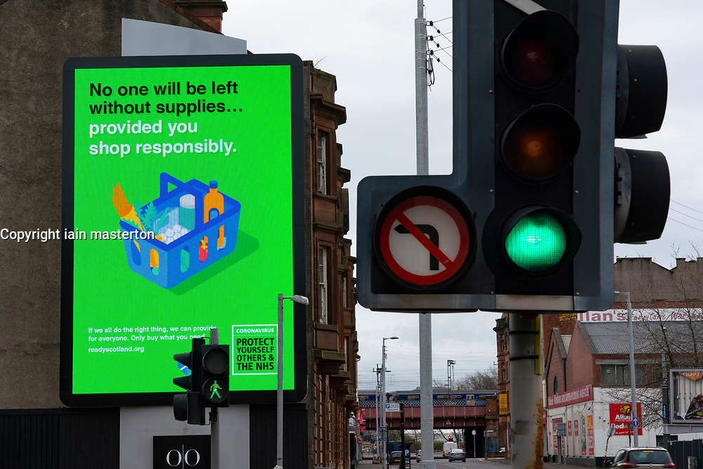 Glasgow, Scotland, UK. 3 April, 2020. Images from the south side of Glasgow at the end of the second week of Coronavirus lockdown. Large video screen in Tradeston with public information message about hoarding food during coronavirus pandemic. Iain Masterton/Alamy Live News