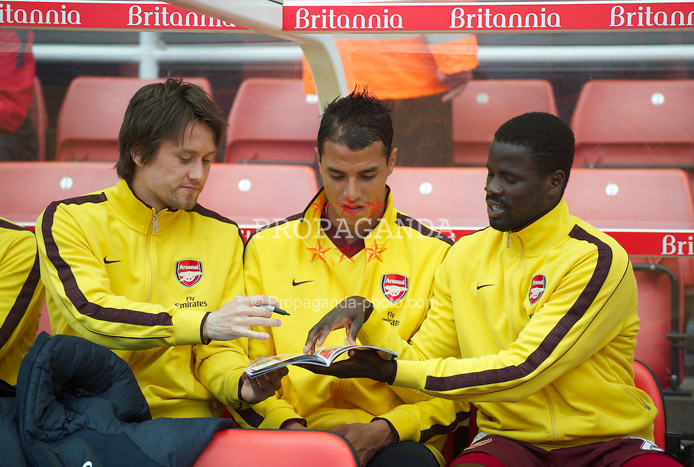STOKE-ON-TRENT, ENGLAND - Sunday, May 8, 2011: Arsenal's substitutes Tomas Rosicky, Marouane Chamakh and Emmanuel Eboue sign a supporter's match program during the Premiership match at the Britannia Stadium. (Photo by David Rawcliffe/Propaganda)