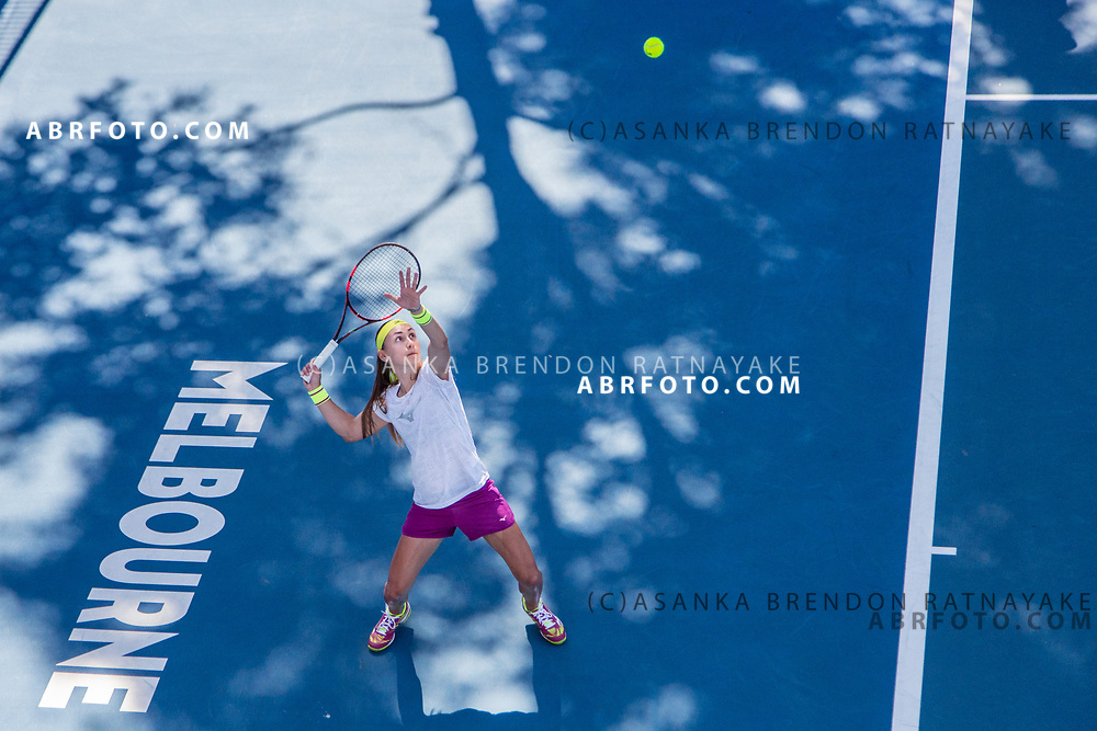 Aleksandra Krunić plays a overhead shot from the baseline during a training session at Melbourne Park in Melbourne, Australia on the 11th of January 2018. Asanka Brendon Ratnayake for The New York Times