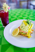 Dill & Chive soft scrambled eggs with smoked salmon, hollandaise, avocado, lemon on a crispy hash brown and Blood Boiler Juice - Carrot, beetroot, apple, ginger.