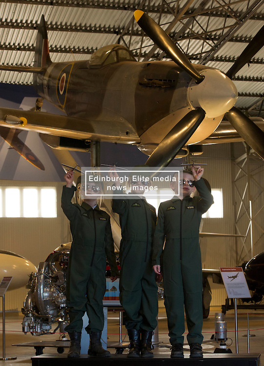 Pictured: Arabella (7), Hannah (7) and Ritchie (6) under the wings of a Spitfire<br /> <br /> The redeveloped National Museum of Flight at East Fortune has undergone a  £3.6 million refurbishment and now has aeroplanes including a Spitfire, a Harrier Jump Jet and a Tornado T-3 on display.    (c) Ger Harley, EEm 22 March 2016
