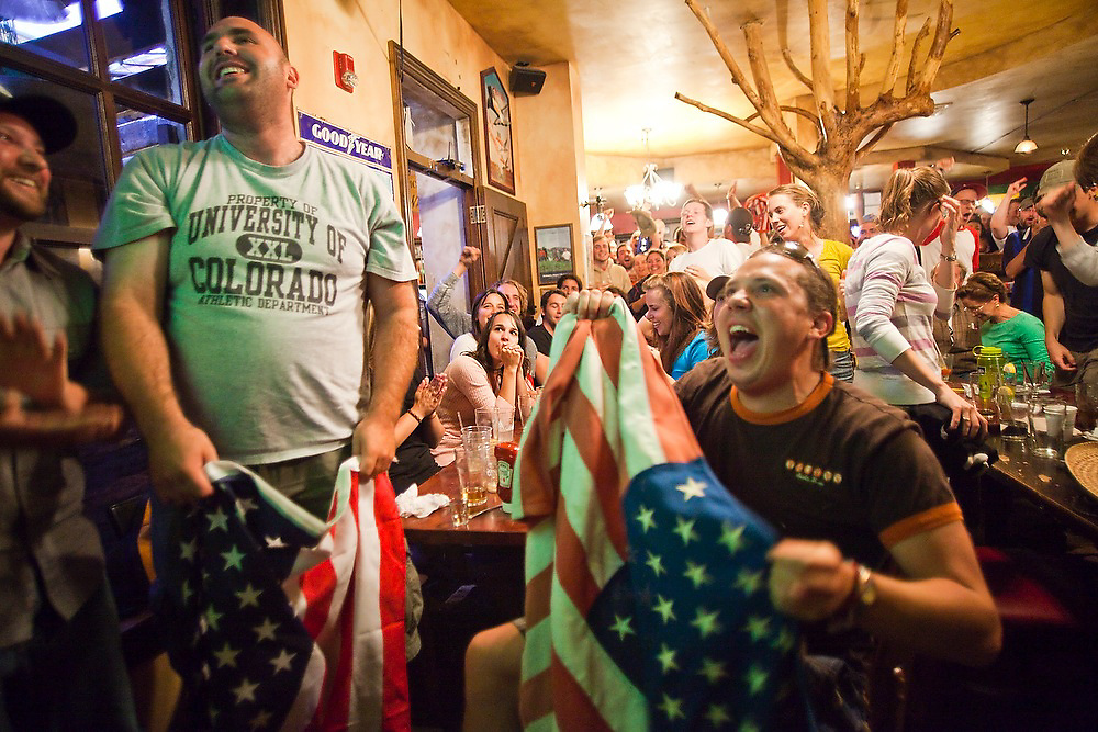 Andrew Pipis (left) and Nick Hess clutch american flags as they watch the World Cup soccer match between England and the USA from Conor O'Neill's pub in Boulder, Colorado on June 12, 2010. The match ended in a 1-1 tie.