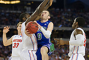 Brett Comer (0) of the Florida Gulf Coast University Eagles drives to the basket against the University of Florida Gators during the NCAA South Regionals at Cowboys Stadium in Arlington on Friday, March 29, 2013. (Cooper Neill/The Dallas Morning News)