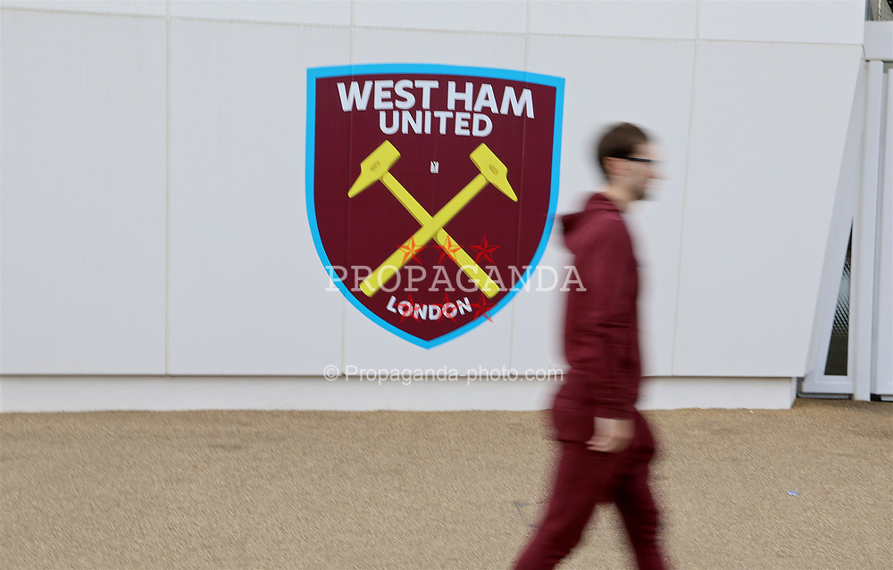 LONDON, ENGLAND - Saturday, April 22, 2017: A man wearing a claret onsie walks past the crest of West Ham United at the London Stadium, before the FA Premier League match against Everton. (Pic by David Rawcliffe/Propaganda)