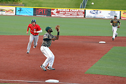 29 July 2016: Nick Covello is forced out by Elvin Rodriguez during a Frontier League Baseball game between the Lake Erie Crushers and the Normal CornBelters at Corn Crib Stadium on the campus of Heartland Community College in Normal Illinois