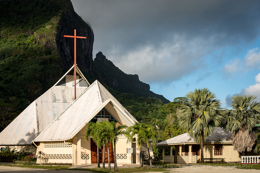A church in Vaitape, the main town on the Island of Bora Bora. Far from the luxury hotels and resorts, the capital of Bora Bora is a busy village built next of the volcanic mountain that overlooks the whole island.