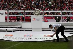 11.05.2013, Allianz Arena, Muenchen, GER, 1. FBL, FC Bayern Muenchen vs FC Augsburg, 33. Runde, im Bild Alles ist vorbereitet fuer die Meisterfeier, ein Arbeiter putzt noch einmal das Podest // during the German Bundesliga 33 th round match between FC Bayern Munich and FC Augsburg at the Allianz Arena, Munich, Germany on 2013/05/11. EXPA Pictures © 2013, PhotoCredit: EXPA/ Eibner/ Klaus Rainer Krieger..***** ATTENTION - OUT OF GER *****