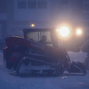 Maintenance crews use a bobcat to plow as heavy snow falls Saturday, Jan, 23, 2016 on Jacobsen Dr. in Newark.<br /> <br /> A blizzard with hurricane-force winds brought much of the East Coast to a standstill Saturday, dumping as much as 3 feet of snow in some places.