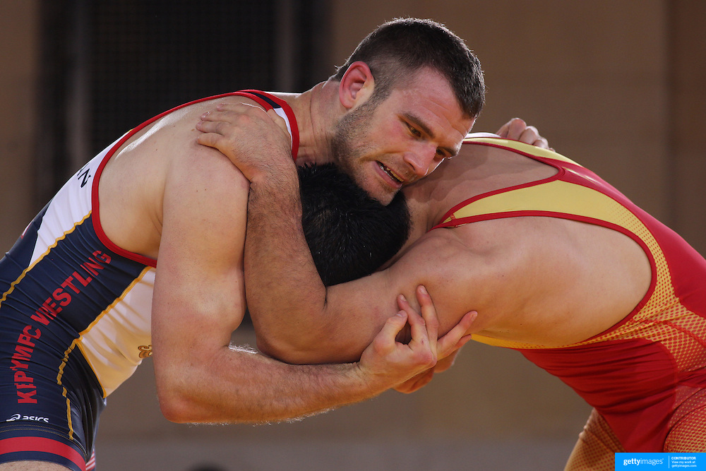 J.D. Bergman, USA, (blue) in action against Hamed Tatari, Iran, (red) as wrestlers from USA, Iran and Russia compete at Grand Central Terminal as part of the Beat the Streets Gala. Billed ?The Rumble On The Rails,? the international wrestling event showcased competition as part of World Wrestling Month. Vanderbilt Hall, Grand Central Station, Manhattan,New York. USA. 15th May 2013. Photo Tim Clayton