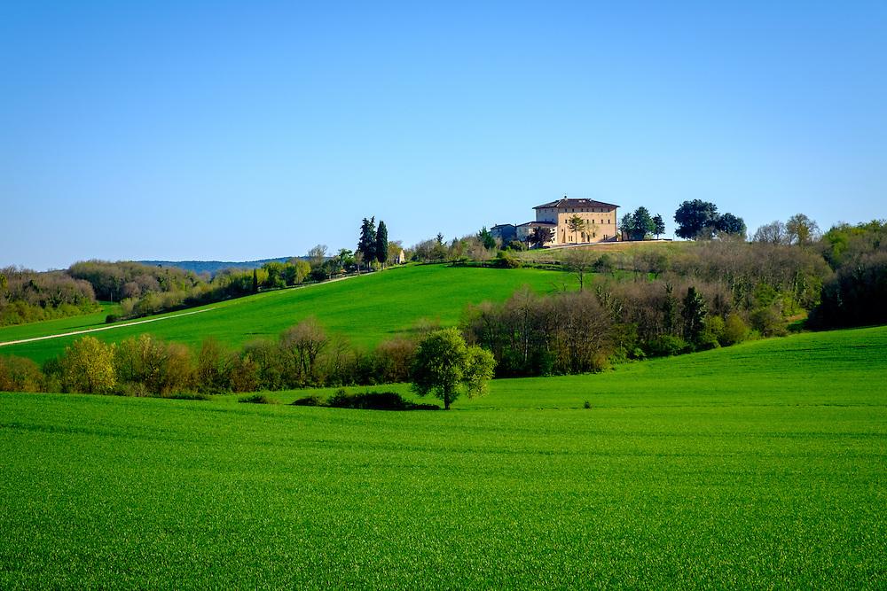 MONTERIGGIONI, ITALY - CIRCA MAY 2015:  House over the hills near San Gimignano in Tuscany