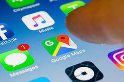Google maps navigation app close up on iPhone smart phone screen