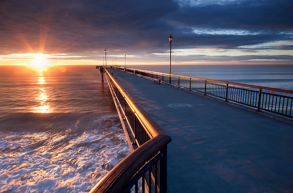 Dramatic sunlight along New Brighton Pier at sunrise, Christchurch, New Zealand