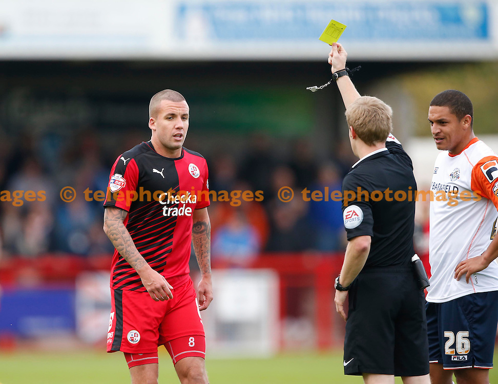 Crawley&rsquo;s Jimmy Smith is shown the yellow card by referee Gavin Ward during the Sky Bet League 2 match between Crawley Town and Luton Town at the Checkatrade.com Stadium in Crawley. October 17, 2015.<br /> James Boardman / Telephoto Images<br /> +44 7967 642437