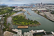 "The natural wild and meandering Duwamish River was ""tamed"" by dredging, filling and straightening that destroyed 98 percent of its natural abundance. Only one natural bend in the river remains, flowing around Kellogg Island, center. It is surrounded by industry and other evidence of the choices made about 100 years ago by city planners and developers, who also drove out the Indian tribes that lived in prominent villages on this spot."
