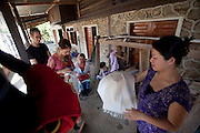 Weavers at Ban Pha Nom, near Luang Prabang, Laos.