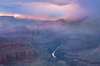 A snow storm hits the Grand Canyon in the late spring during sunset