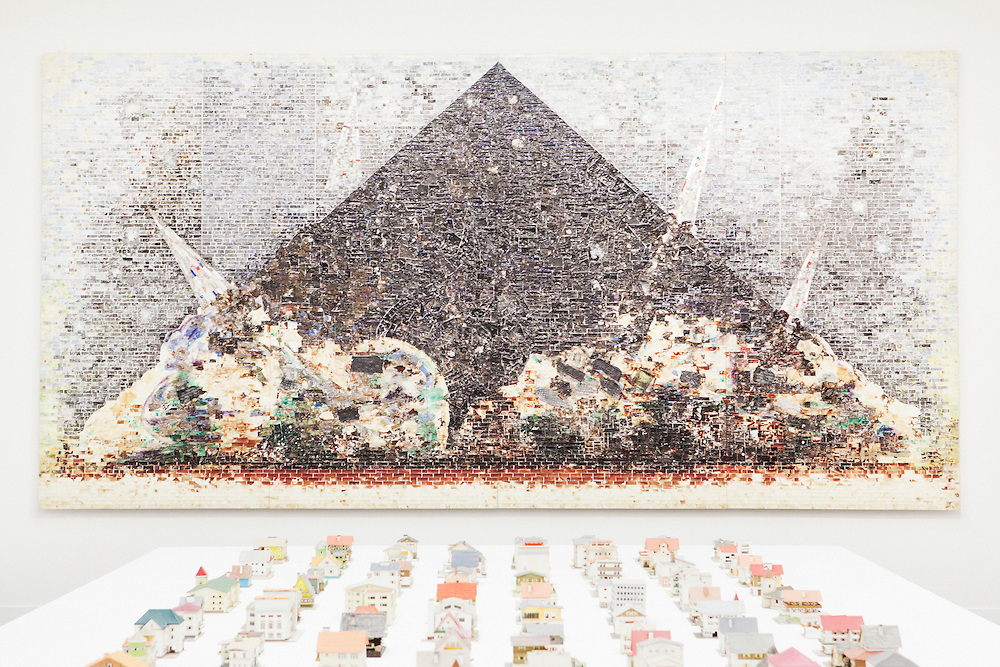 VENICE, ITALY - 31 MAY 2013: Foreground, Oliver Croy and Oliver Elser's &quot;The 387 houses of Peter Fritz&quot; (1916-1992) - a selection of 176 models; background, Jack Whitten's &quot;9-11-01&quot; (2006) - mixed media and acrylic on canvas - at the exhibition &quot;Il Palazzo Enciclopedico&quot; (The Encyclopedic Palace) at the Central Pavillon at the Giardini of the Biennale in Venice, Italy, on May 31st 2013. <br /> <br /> The Exhibition Il Palazzo Enciclopedico (The Encyclopedic Palace) will be laid out in the Central Pavilion (Giardini) and in the Arsenale forming a single itinerary, with works spanning over the past century alongside several new commissions, including over 150 artists from 38 countries. Il Palazzo Enciclopedico (The Encyclopedic Palace) investigates the desire to see and know everything: it is a show about obsessions and about the transformative power of the imagination. The exhibition opens in the Central Pavilion with a presentation of Carl Gustav Jung's Red Book.<br /> <br /> The 55th International Art Exhibition of the Venice Biennale takes place in Venice from June 1st to November 24th, 2013 at the Giardini and at the Arsenale as well as in various venues the city. <br /> <br /> Gianni Cipriano for The New York TImes
