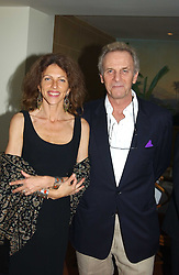 MARK & CLEO SHAND he is the brother of HRH The Duchess of Cornwall at a fundraising dinner for the charity 'Elephant Family' held at The Bombay Brasserie, Gloucester Road, London on 26th April 2005.<br />