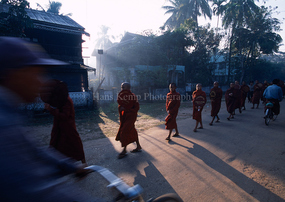 Monks collecting alms in Pathein.