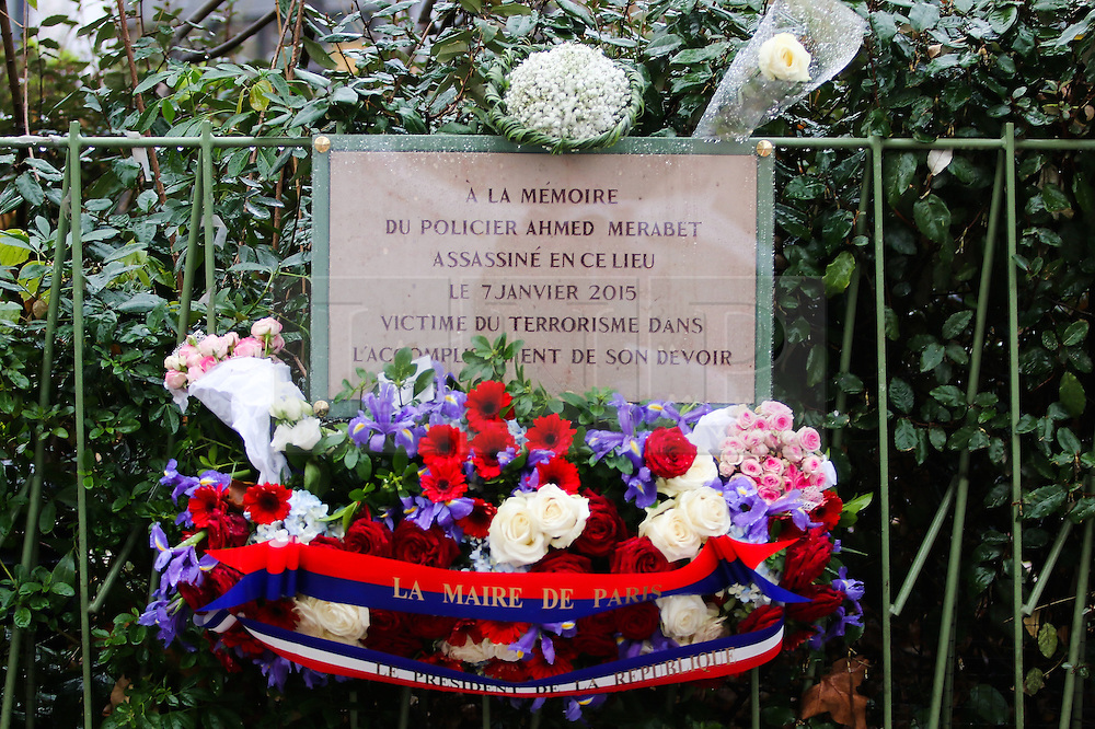 © Licensed to London News Pictures. 07/01/2016. Paris, France. Flowers are laid by Members of the public to remember the killing of police officer Ahmed Marabet who died during the Charlie Hebdo shooting on Jaury 7th 2015. Today January 3rd 2016. Photo credit: Hugo Michiels/LNP
