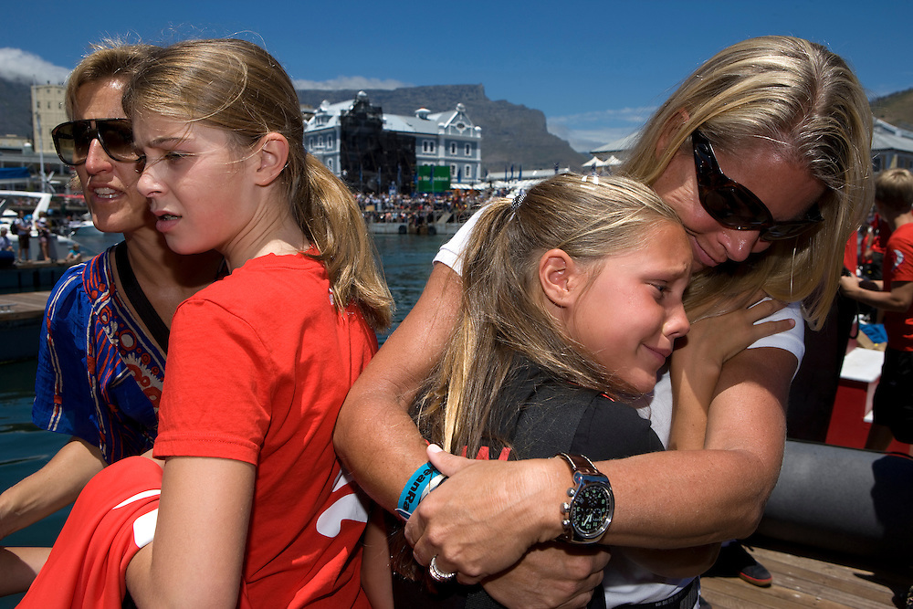 15NOV08. One big family: Rick Deppe's wife Anastasia (left), consoles Ken Read's daughter Tori (second left), and Kathy Read (far right) gives a hug to Sidney Gavignet's daughter.