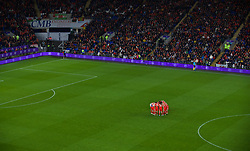 CARDIFF, WALES - Sunday, October 13, 2019: Wales players for a group huddle before the UEFA Euro 2020 Qualifying Group E match between Wales and Croatia at the Cardiff City Stadium. (Pic by Paul Greenwood/Propaganda)
