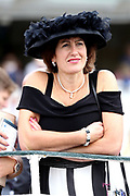 Lady in black watching the racing  during the Yorkshire Ebor Festival, Darley Yorkshire Oaks, at York Racecourse, York, United Kingdom on 23 August 2018. Picture by Mick Atkins.