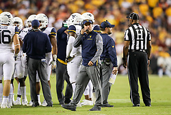 Sep 3, 2017; Landover, MD, USA; West Virginia Mountaineers head coach Dana Holgorsen looks at the scoreboard during the fourth quarter against the Virginia Tech Hokies at FedEx Field. Mandatory Credit: Ben Queen-USA TODAY Sports