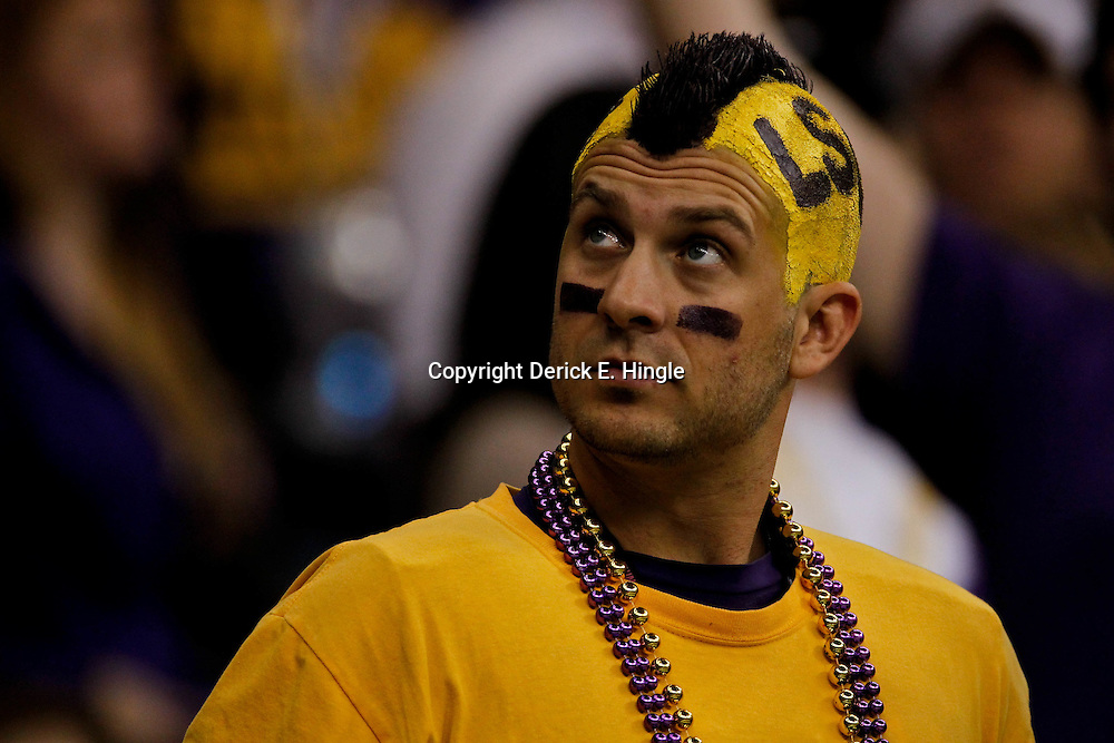 Jan 9, 2012; New Orleans, LA, USA; A LSU fan looks on during the forth quarter of the 2012 BCS National Championship game against the Alabama Crimson Tide at the Mercedes-Benz Superdome.  Mandatory Credit: Derick E. Hingle-US PRESSWIRE