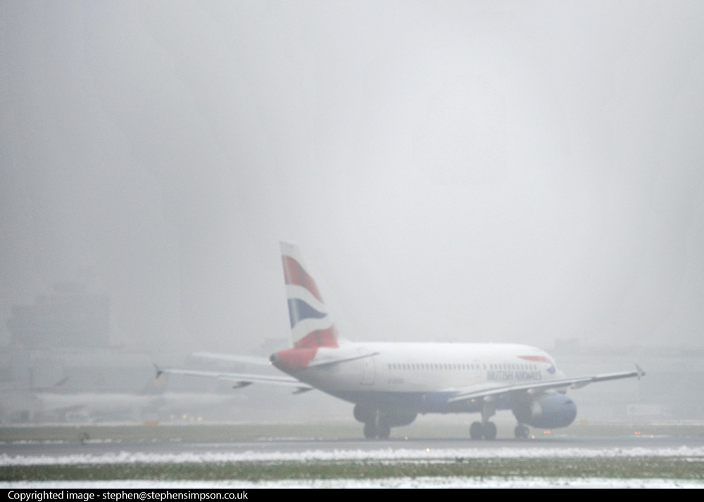 © Licensed to London News Pictures. 06/02/2012, Heathrow, UK. A british Airways aircraft takes off in fog. Snow and heavy fog continue to disrupt flights at Heathrow Airport today 6th February 2012. Heavy snow fell over many parts of the South East of the UK over Saturday night.  Photo credit : Stephen Simpson/LNP