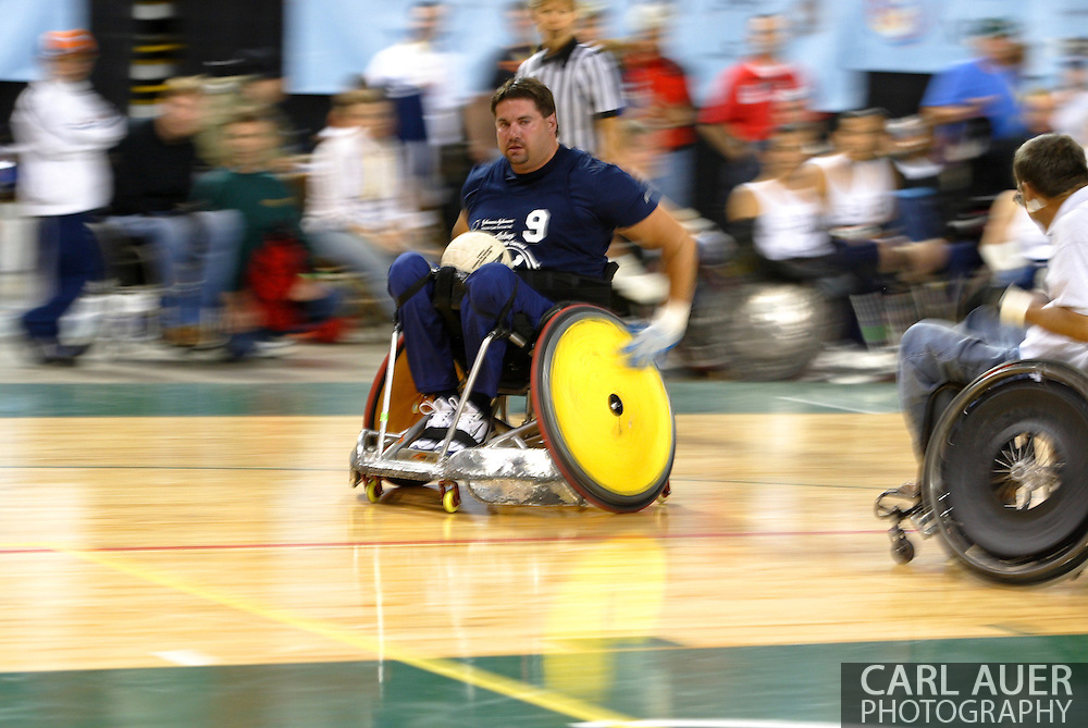 July 7th, 2006: Anchorage, AK - Scot Severn (9) speeds down the floor as White defeated Blue in the gold medal game of Quad Rugby at the 26th National Veterans Wheelchair Games.