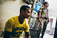 An inmate and a guard at Klong Prem prison in Bangkok, Thailand. The inmate is part of a program that pits prisoners against foreign Muay Thai fighters for a chance of reduced sentencing or early release.