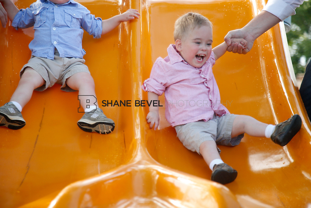 5/28/15 6:04:34 PM -- Miracle Miles and his family pose for portraits and play at the QuikTrip park for the 2015 Saint Francis Health System advertising campaign. <br /> <br /> Photo by Shane Bevel