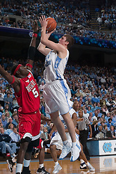 28 December 2006: North Carolina Tarheel forward (50) Tyler Hansbrough shoots over Rutgers center (5) Hamady N'Diaye during a 87-48 Rutgers Scarlet Knights loss to the North Carolina Tarheels, in the Dean Smith Center in Chapel Hill, NC.<br />