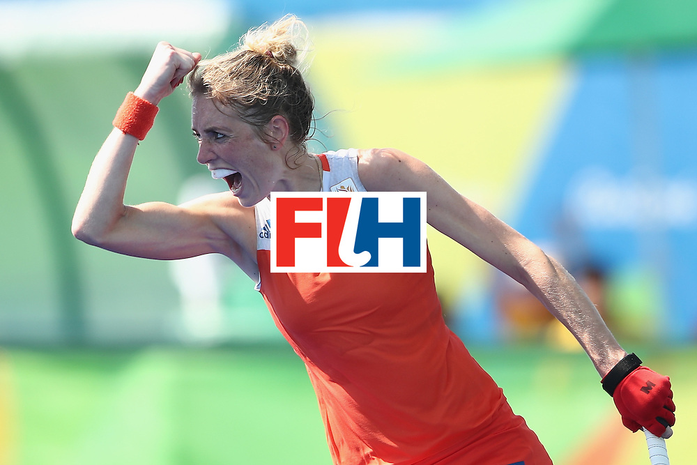 RIO DE JANEIRO, BRAZIL - AUGUST 17:  Willemijn Bos of the Netherlands celebrates scoring a goal in the penalty shootout during the womens semifinal match between the Netherlands and Germany on Day 12 of the Rio 2016 Olympic Games at the Olympic Hockey Centre on August 17, 2016 in Rio de Janeiro, Brazil.  (Photo by Mark Kolbe/Getty Images)