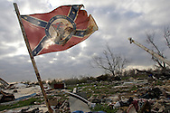 """A southern flag that reads """"The South Will Rise Again"""" flies over damage in Plaquemines Parshish..Plaquemines Parish took the most heavy damage from hurricane Katrina. Located south of New Orleans, Plaquemines Parish had a large Shrimping fisherman community which was completely destroyed by Katrina. It is just starting to rebound six months after Katrina."""