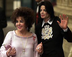Michael Jackson stands with Liz Taylor  as they arrive at the Royal Albert Hall for a musical celebration, London, May 26, 2000. Photo by Andrew Parsons / i-images..