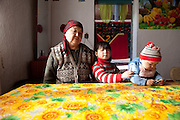 "Kyrgyzstan: Aisha Alieva, 62, raises two grandchildren in Ak-Kiya. Her sons in Russia haven't visited in three years. ""Children want to leave as well. They want to study and leave for work like their fathers. It would be nice if they wouldn't leave, if they lived in their villages and cities in their own country."" February 2010."