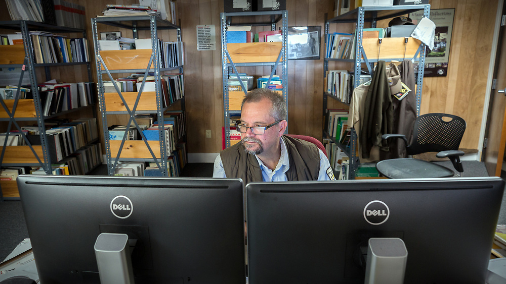 BLUFFTON, S.C. - FEBRUARY 20, 2018:<br /> Rick Kanaski, Regional Archaeologist &amp; Regional Historic Preservation Officer for the U.S. Fish and Wildlife Service, works at his desk in the Savannah National Wildlife Refuge. (WABE Photo/Stephen B. Morton)