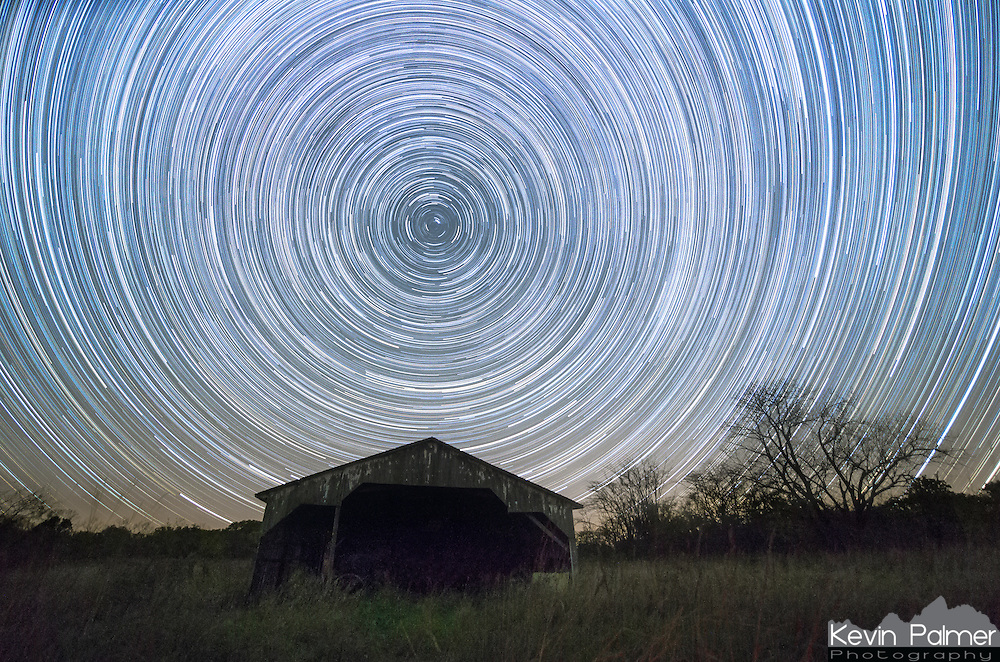 Stars appear to rotate above this abandoned barn in 3 hours time. In reality it is the stars that are stationary and the earth that is rotating. In 23 hours and 56 minutes, the stars make one counterclockwise rotation of 360 degrees. This 4 minute difference is what causes the stars to change position from night to night, and the constellations to change from season to season. Earth's northern axis happens to be pointed at Polaris, or the North Star. It hardly moves at all in the course of a night. For thousands of years people have been using Polaris to navigate. It not only tells you which way is north, but it also tells you your latitude. In this case the North Star was 40 degrees above the horizon. Those in the southern hemisphere do not have such a star to guide them.<br />