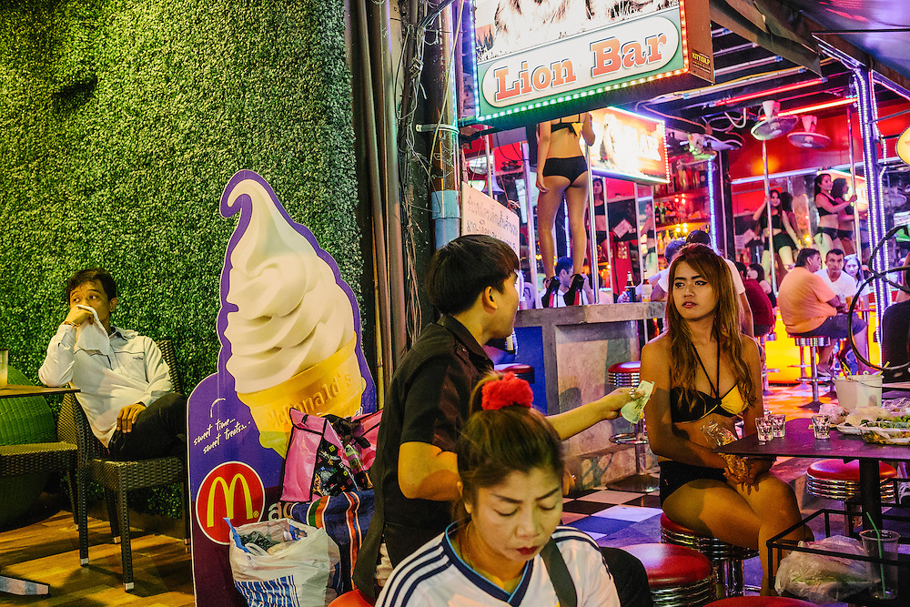 Skimpily dressed Thai women who work in the GoGo bars as dancers take a break outside the bar.