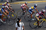 Athletes compete in stage seven of the annual Vuelta al Tachira cycling race in El Vigia, Venezuela on Friday, Jan. 11, 2008. Local and international teams will ride over 1580 kilometers and climb a 1500 meter altitude differential throughout the competition. The grueling, 13-stage race through the Andes mountains is hailed as the premier cycling event in South America. ..