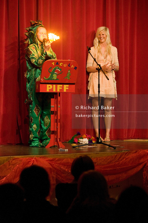 The magic act Piff the magic Dragon helped with female member of the audience performs on stage in London