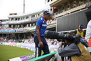 England Chris Jordan walks off injured during the Royal London One Day International match between England and New Zealand at the Oval, London, United Kingdom on 12 June 2015. Photo by Phil Duncan.