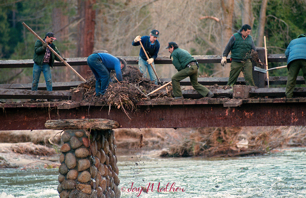 Yosemite National Park trail crews work to clear debris from Swinging Bridge in the valley where the Merced River floodwaters overflowed the floodplain.  January 1997