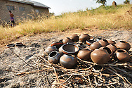 Traditional Venda pots being fired at CC Potters with sticks and grass in Guyani, Limpopo, South Africa