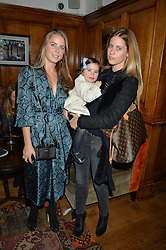 LONDON, ENGLAND 1 DECEMBER 2016: Lydia Forte, Ella Vestey, Violet Vestey Left to right, at the Smythson & Brown's Hotel Christmas Party held at Brown's Hotel, Albemarle St, Mayfair, London, England. 1 December 2016.